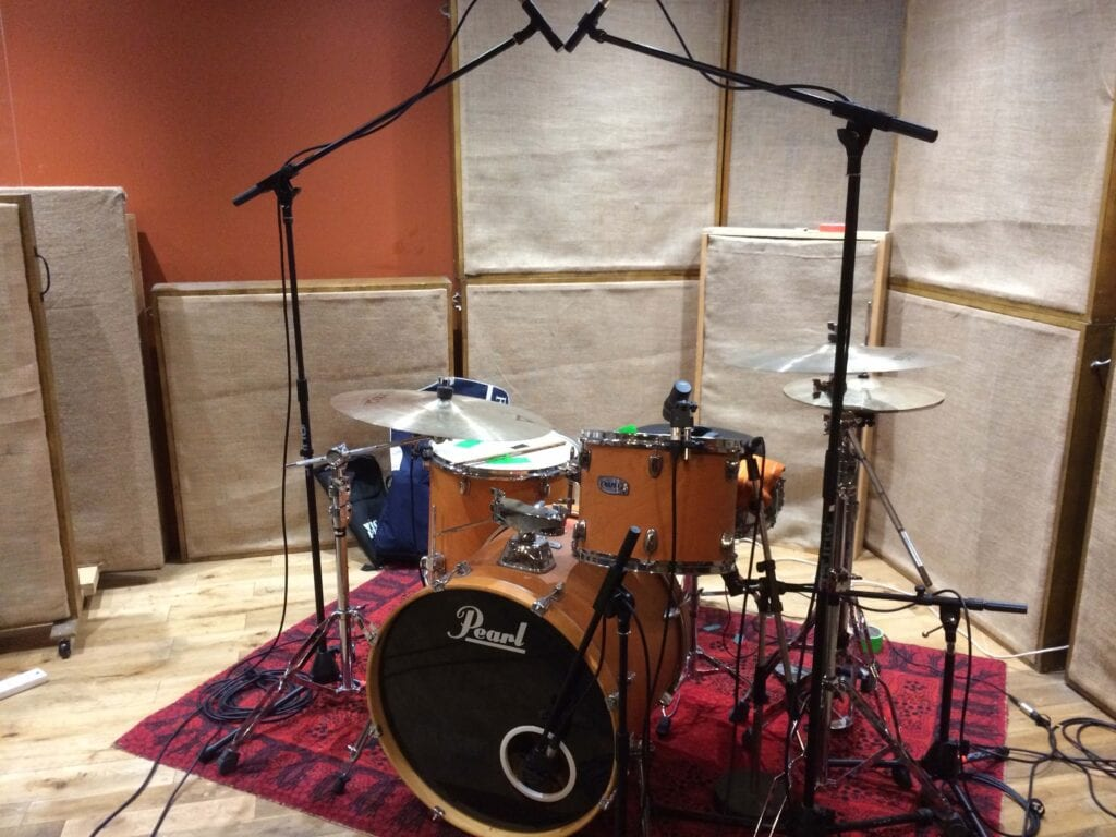 Drum kit miked in studio